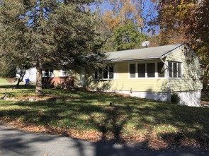 Situated On A Level Corner Lot