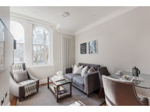 A luxury one bedroom, one bathroom second-floor apartment within this stunning Grade II li